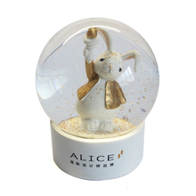 Cute rabbit with golden cloth snow globe custom made white base animal snow ball