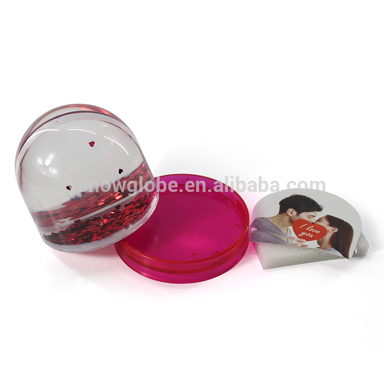 Plastic snow globe with photo insert