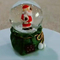 Resin santa snow globe with blowing snow