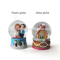 2018 cheap dubai plastic snow globe